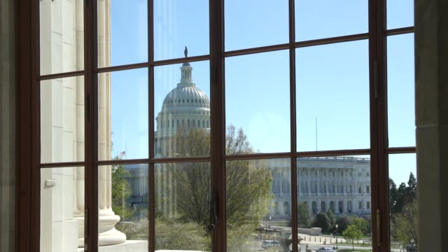 view of the u.s. capitol from the senate russell office building rotunda in washington, dc - neo classical stock videos & royalty-free footage