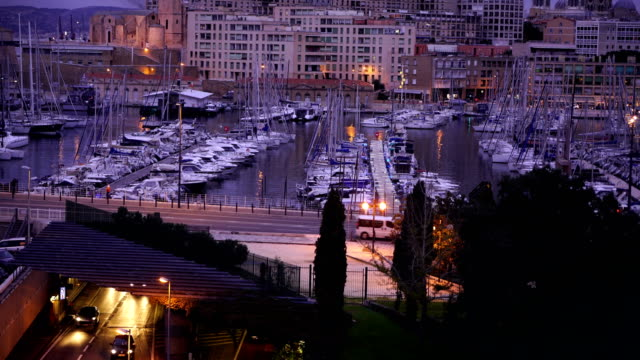 view of the vieux port (old port) in marseille at twilight, france - notre dame de la garde marseille stock videos and b-roll footage