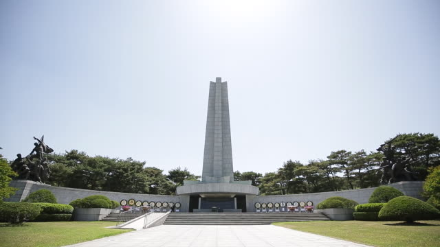 view of the war memorial at seoul national cemetery - female likeness stock videos & royalty-free footage