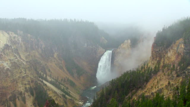 view of the waterfalls while it's snowing - yellowstone river stock videos and b-roll footage