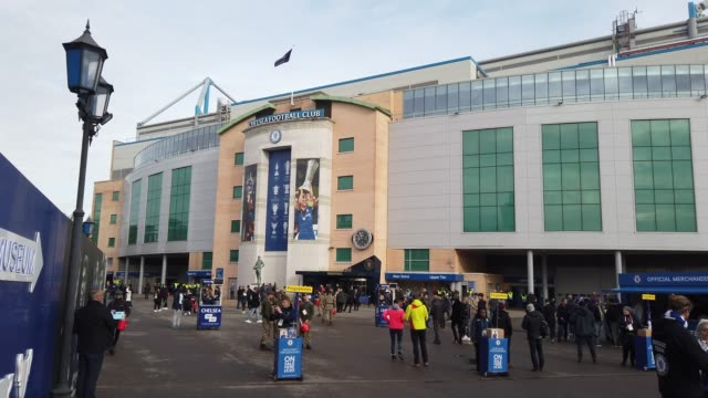 view of the west stand of stamford bridge as fans arrive prior to the premier league match between chelsea fc and crystal palace at stamford bridge... - チェルシーfc点の映像素材/bロール
