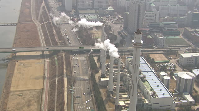 ws aerial ts view of thermal power plant with smoke at mok dong seoul / seoul, south korea - mok stock videos and b-roll footage