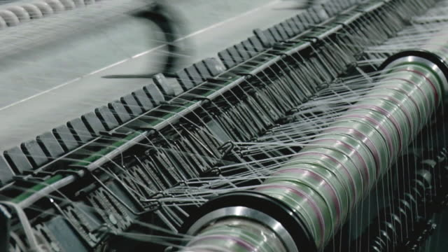 cu view of threads in machine, kanakaria textile mills / ahemdabad, gujarat, india  - 織物工場点の映像素材/bロール