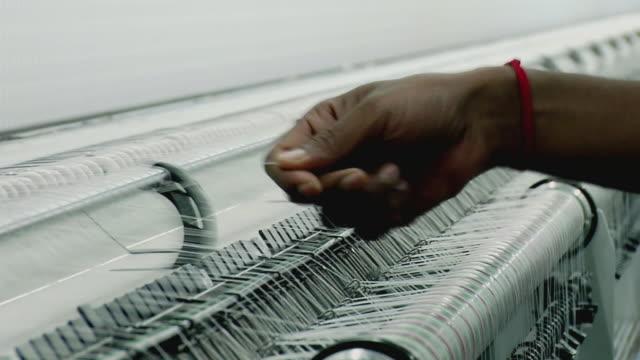 CU View of threads in machine, Kanakaria textile mills / Ahemdabad, Gujarat, India