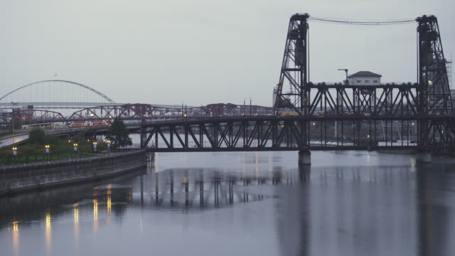 WS View of Three bridges of Freemont, Broadway and Steel bridge cross Willamette River in Portland, Oregon at dusk on rainy day / Portland, Oregon, United States