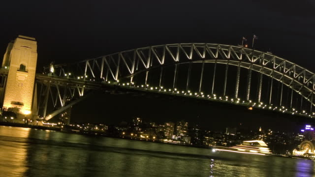 WS TU T/L View of thunderstorm with lightning above the Sydney Harbor Bridge at night / Sydney, New South Wales, Australia.