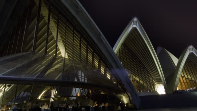 WS PAN T/L View of thunderstorm with lightning over Sydney Opera House Restaurant at night / Sydney, New South Wales, Australia.