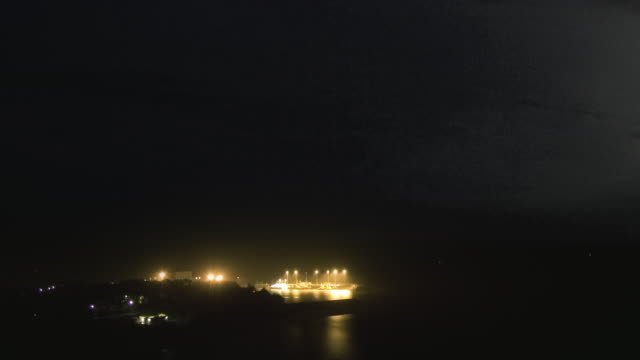 WS ZO T/L View of thunderstorm with lightning over the Darwin harbor / Darwin, Northern Territory, Australia.