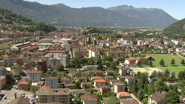 ws aerial view of ticino river and bellinzona with sbb industrial plant with castles castelgrande / bellinzona, ticino, switzerland - ticino canton stock videos and b-roll footage