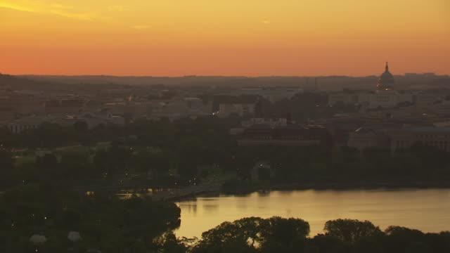 WS AERIAL POV View of Tidal Basin and Washington Monument during sunrise / Washington DC, United States