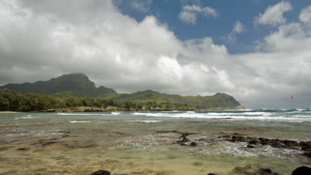 ws t/l tu view of tide pool with mountain in background  / poipu, kauai, hawaii, usa  - tide pool stock videos & royalty-free footage
