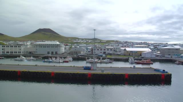 ws pov view of tie boats at port of vestmannaeyjar island / vestmannaeyjar, sudhurland, iceland - wiese stock videos & royalty-free footage