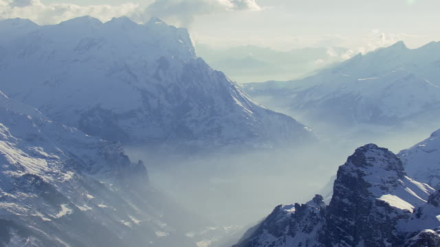 ws aerial view of titlis / switzerland - snowcapped mountain stock videos and b-roll footage