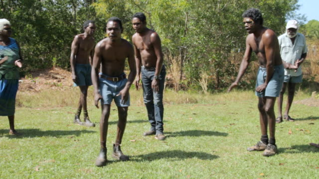 ms view of tiwi island natives performing native dance / northern territory, australia - jeans stock videos & royalty-free footage