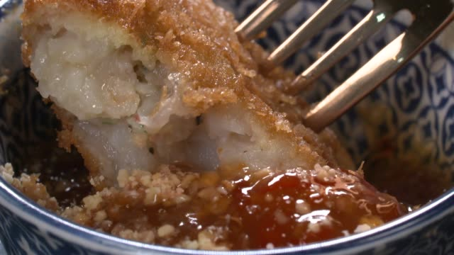view of tod mun kung(fried shrimp patty in thailand) being dipped into thai sauce - deep fried stock videos & royalty-free footage