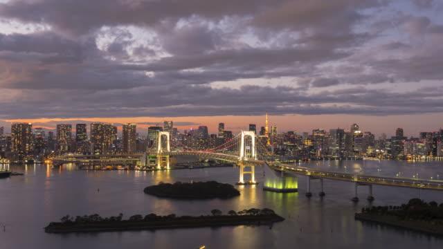 view of tokyo rainbow bridge day to night time lapse - horizontal stock videos & royalty-free footage