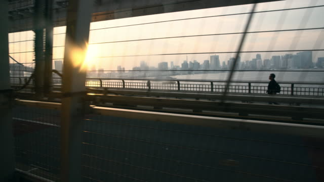 view of tokyo skyline through a lightrail window - monorail stock videos & royalty-free footage