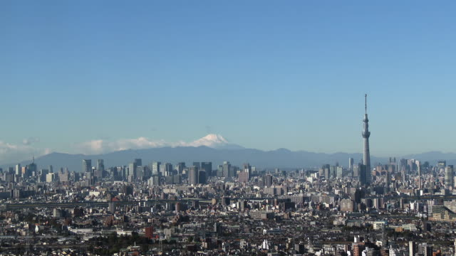 ws view of tokyo skytree with city and mount fuji / tokyo, japan - スカイツリー点の映像素材/bロール