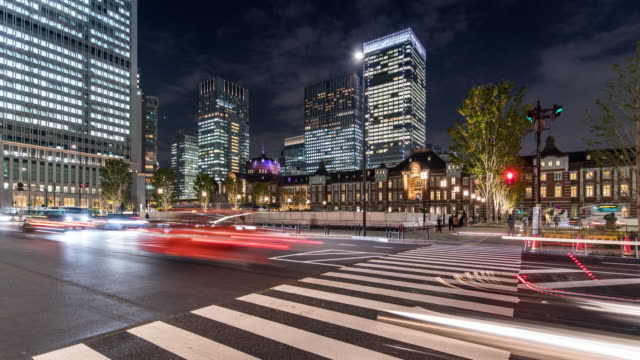 T/L WS ZI POV View of Tokyo Station and Modern Skyscrapers at Night/ Tokyo, Japan