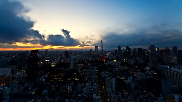 T/L WS View of Tokyo Tower at sunset / Tokyo, Japan