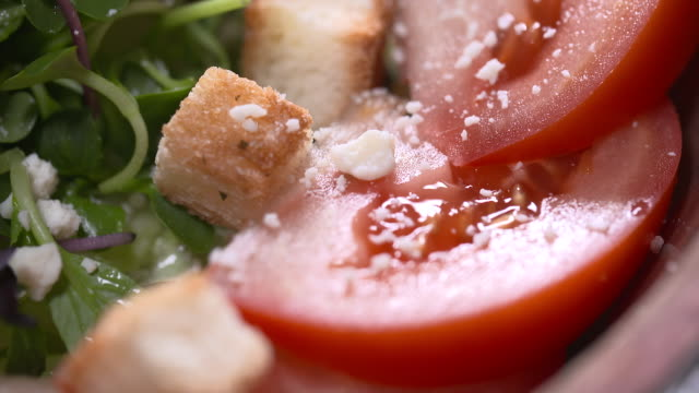 view of tomato salad with vegetable and bread - tomato salad stock videos & royalty-free footage