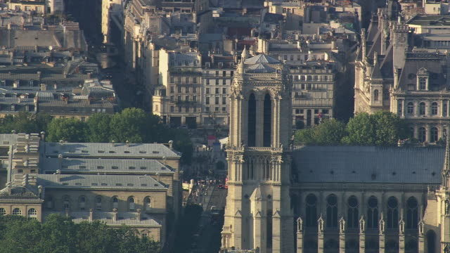 MS AERIAL View of top part of Notre Dame in city / Paris, France