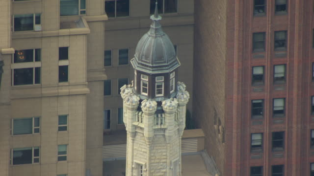 WS AERIAL POV TD View of top section of Chicago Water Tower / Chicago, Cook County, Illinois, United States