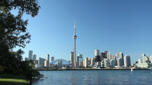 WS View of Toronto skyline with CN tower and windmill in front of lake / Toronto, Ontario, Canada