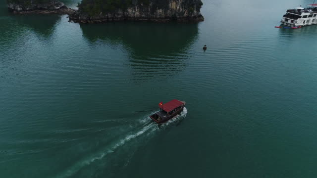 view of tourboat at halong bay (unesco world heritage site),vietnam - tourboat stock videos & royalty-free footage