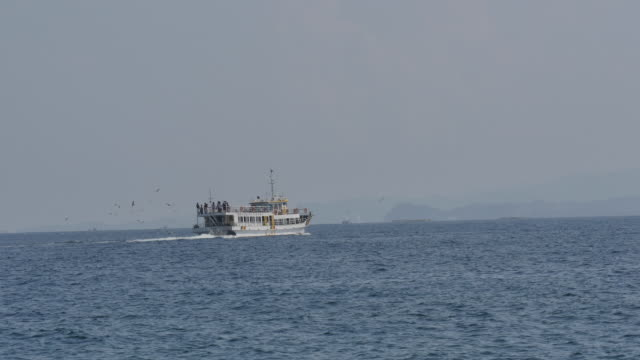 view of tourboat on the sea in dongmyeong-port - tourboat stock videos & royalty-free footage