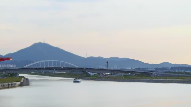 ws t/l view of tourboat passing through  bridge in gyeongin ara waterway / incheon, south korea - tourboat stock videos & royalty-free footage