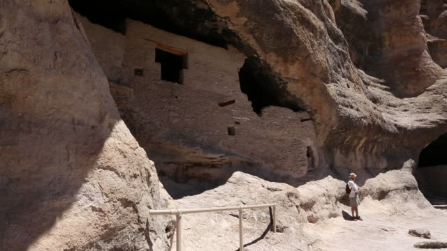 ws view of tourist at gila cliff dwellings national monument / catron, new mexico, united states - cliff dwelling stock videos & royalty-free footage