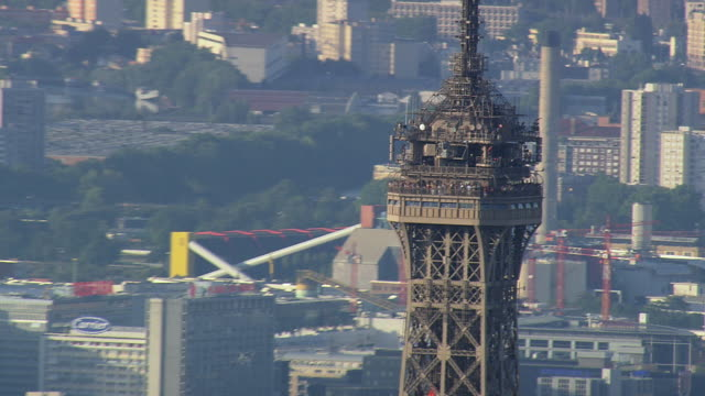ms aerial ds pan view of tourist at top part of eiffel tower in city / paris, france - eiffel tower paris stock videos & royalty-free footage