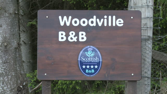 MS View of tourist board near city / Cromdale, Speyside, Scotland