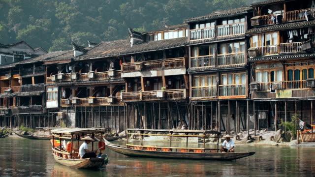 view of tourist boat at fenghuang(phoenix) ancient town,hunan, china. - 男漁師点の映像素材/bロール