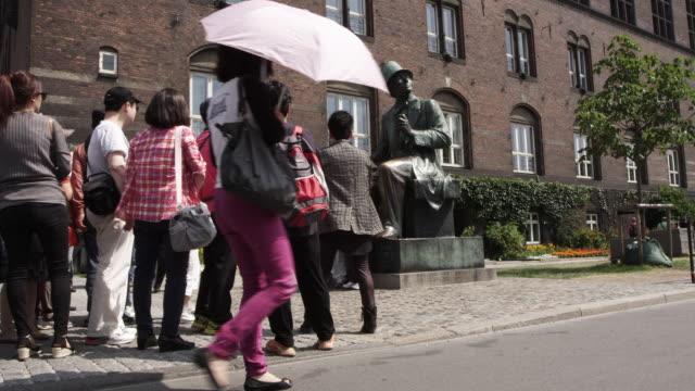 ws view of tourist crowd near hc anderson statue and building / copenhagen, denmark - oresund region stock videos & royalty-free footage