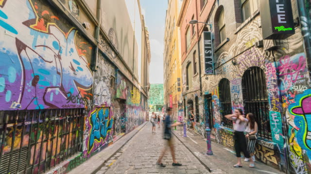 view of tourist enjoying graffiti street (famous travel destinations) in hoiser lane - graffiti stock videos & royalty-free footage