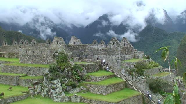ws view of tourist moving at machu picchu / machu picchu, cusco, peru - machu picchu stock videos and b-roll footage