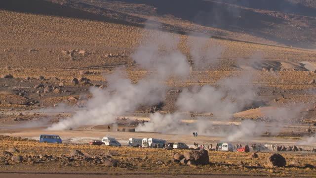 ws view of tourist vehicles among steaming vents at el tatio geysers / san pedro de atacama, norte grande, chile - san pedro de atacama stock videos & royalty-free footage