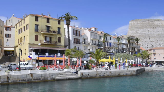 WS View of Tourist walking at waterfront in harbor of Calvi / Calvi, Corsica, France