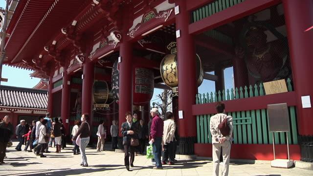ms view of tourists at kaminarimon gate / tokyo, kanto, japan - japan stock videos & royalty-free footage
