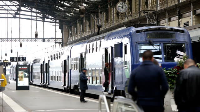 view of tourists coming to take a train at a platform of lyon station (main station of paris) - train vehicle stock videos & royalty-free footage