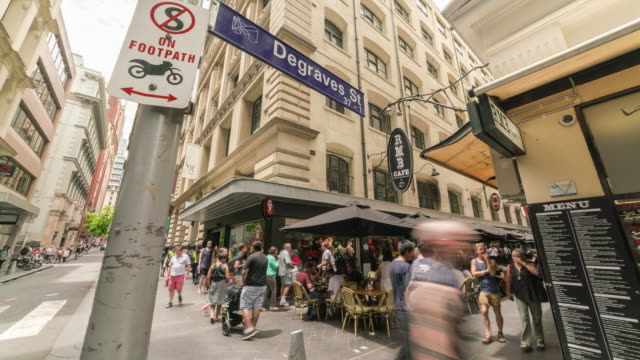 view of tourists enjoying in degraves street (famous place as coffee street) - road sign stock videos & royalty-free footage