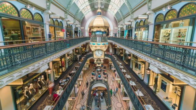 vídeos de stock, filmes e b-roll de view of tourists enjoying shopping mall of queen victoria building and rotating clock - sydney australia