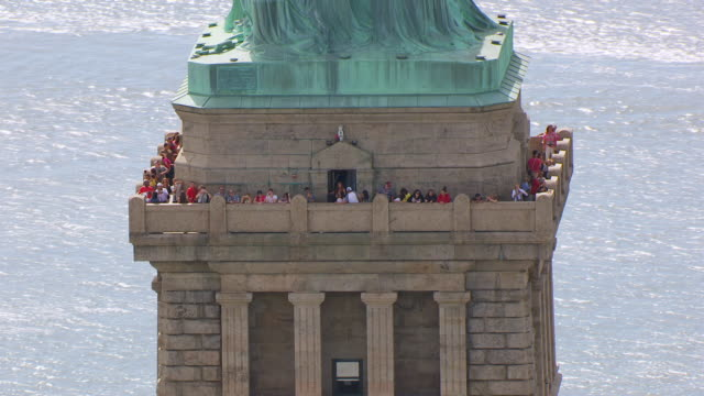 MS AERIAL DS View of tourists on balcony of Statue of Liberty at Liberty island / New Jersey, United States