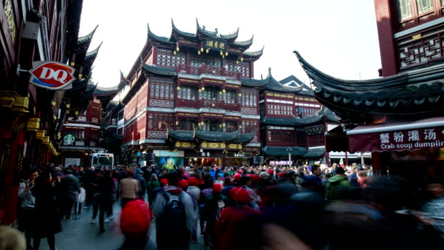 view of tourists on yu yuan gardens at daytime in shanghai, china - classical chinese garden stock videos & royalty-free footage