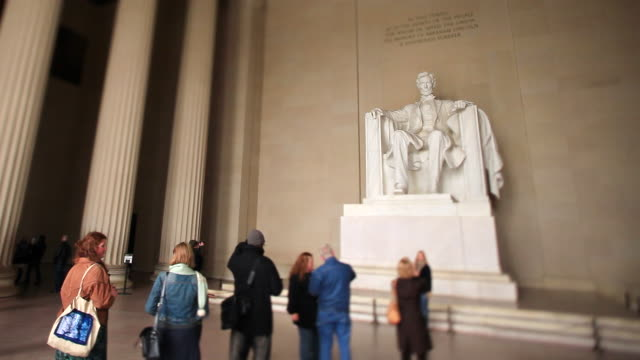 WS View of Tourists stand next to Abraham Lincoln statue at Lincoln Memorial in Washington DC / Washington, District of Columbia, United States