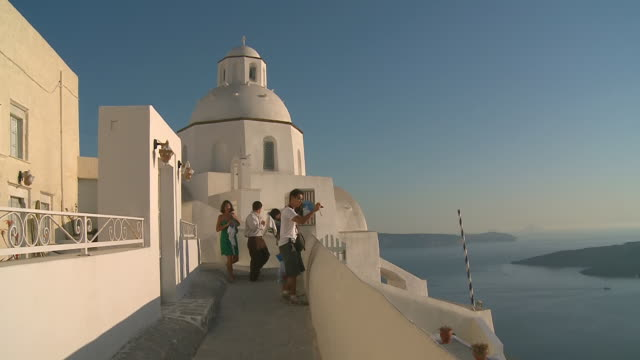 ws view of tourists walking at village thira / santorini, cyclades, greece - santorini stock videos & royalty-free footage
