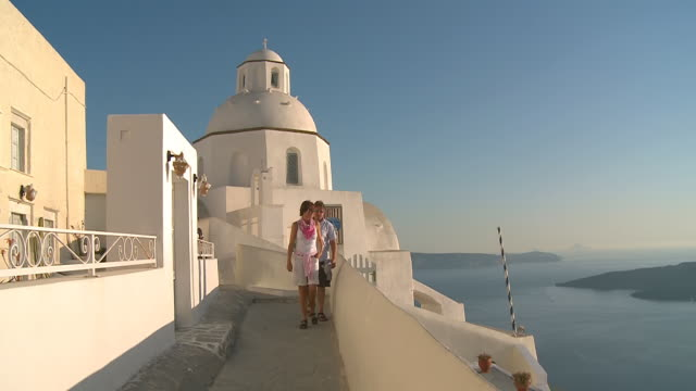 WS View of tourists walking at village Thira / Santorini, Cyclades, Greece