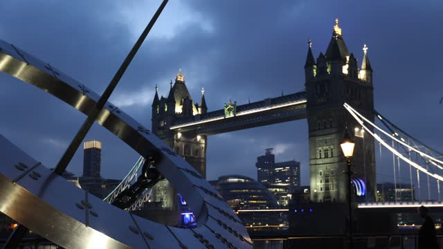 view of tower bridge, illuminated in the evening with the sun dial in the foreground from st katherines dock on november 28, 2020 in london, england. - image focus technique stock videos & royalty-free footage